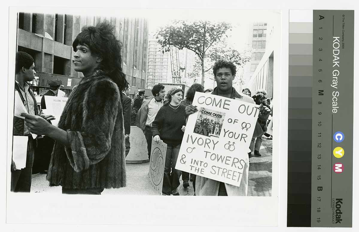 Diana-Davies,-Untitled-(Marsha-P.-Johnson-Hands-Out-Flyers-for-Support-of-Gay-Students-at-N.Y.U.)